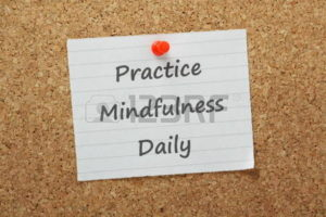 27306896-the-phrase-practice-mindfulness-daily-on-a-piece-of-paper-pinned-to-a-cork-notice-board-a-mental-sta